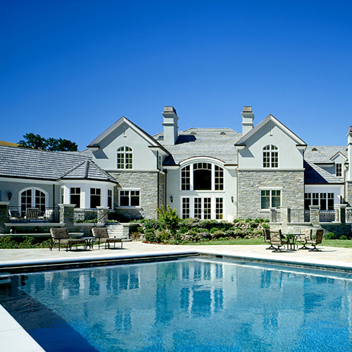large home and pool backyard