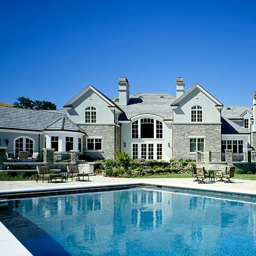 large home and pool backyard